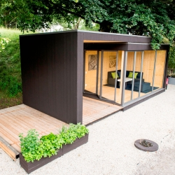 Kenjo's prefab Friluftsstugan (Outdoor Cottage) slides open to double outside space.