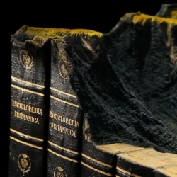 Adieu. Guy Laramée turns a set of Encyclopedia Brittanica into a mountain range.