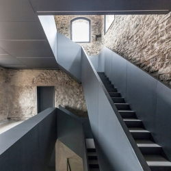 Torre del Borgo, a 12th century tower outside Bergamo, gets a modern makeover from Gianluca Gelmini.