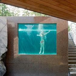 An aquarium style pool in Villa Midgård by DAPstockholm.