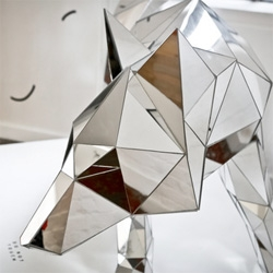 Beautiful illustration and sculpture from Arran Gregory. Here's his mirrored faceted wolf (see the bear too!)