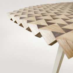 Atlas, a dining table by The Fundamental Shop (Gunnar Rönsch & Stephen Molloy). The table is crated from a cube of oak rotated by 45 degrees on two of its axis and planed off the pointy surface.
