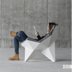 The Lounge chair Q1 by ODESD2 based on Richard Buckminster Fuller's spherical thin-shell structure.