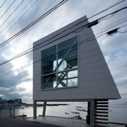 The Window House, a tiny seaside getaway by Yasutaka Yoshimura on the edge of Sagami Bay.