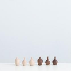 Magnetic wooden pottery hooks by Masaharu Asano.