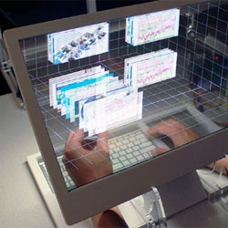 Jinha Lee and Cati Boulanger of Microsoft's Applied Sciences Group have created a desktop display with a transparent 3D monitor.