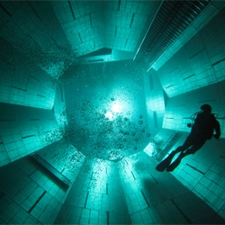 Nemo 33, a Brussels Diving Centre and home to the world's deepest swimming pool containing 2,500,000 litres of water and a large circular pit plunging to a distance of 33m (108 ft)!