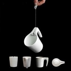 Samir Sufi's Tea Cup SlingsHOT, a mug designed to stop your tea bag from slipping out of reach and allowing you to squeeze it dry.