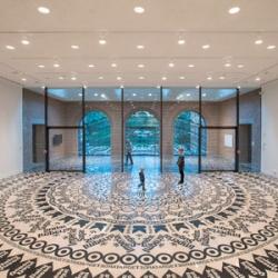 Gunilla Klingberg's Wheel of Everyday Life at the Rice Gallery is a giant mandala made from rand logos.