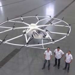 The flight of the Volocopter VC200 which uses 18 propellers.