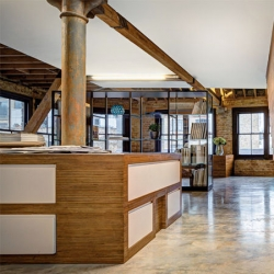 DOS Architects' design of the offices for MAD Agency London in a former industrial building near Old Street.