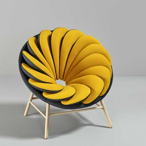 The Quetzal chair inspired by the feathers of a quetzal designed by Marc Venot.