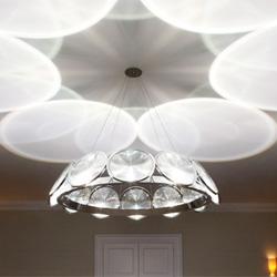 Circles and Countercircles, a single lens chandeliers from Troika.