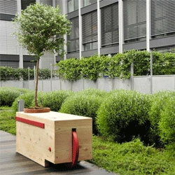 Stefano Sciullo's Log Bench, part planter, part bench and easily moved like a wheelbarrow!