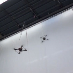 Two quadrocopters balance an inverted pendulum, then actually throw and catch the pole.