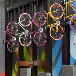 Mim Design Stuidio gives an old, inner city power station new graphics. Creative artwork includes airborne bicycles, neon light fixtures and series of futurists graphics in brazen 60's colors.