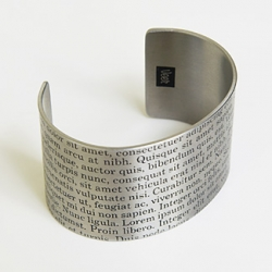 oooh!  a lorem ipsum cuff.  style. from veer!