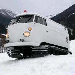Snow tracks made from a Volkswagen van. It's also a DJ bus with automatic pop-top to address public events!