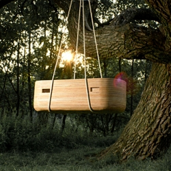 The NOAH Cradle is a beautiful hand crafted wood crib that can be hung from a tree in an open forest – or a ceiling in your nursery!