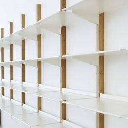 Revolver shelf system design by Henny Van Nistelrooy. Made out of wood and steel.