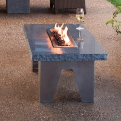 The Vesta Fire Table is both a table and fireplace. Lovely dual purpose piece of outdoor furniture from Stone Forest.