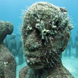 Jason de Caires creates sculptures underwater and leaves them to grow organically. Until we find Atlantis, this does quite nicely.