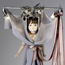 Dutch fashion designers Viktor & Rolf have miniaturised their entire collection down to doll size .