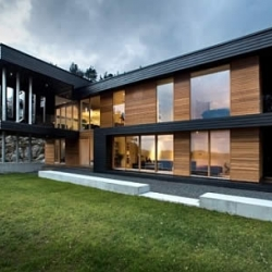Located on the West Coast of the Bergen archipelago in Norway, Villa Storingavika is one of the most strikingly beautiful structure clad in glass, black stained wood and oiled natural wood.