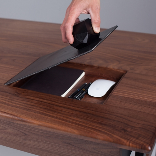 The Woolsey Agent Desk comes with a built in leather mouse pad, that secretly opens with a magnetic wood geode to provide storage for your notepad, mouse, and pencils. Brilliant!