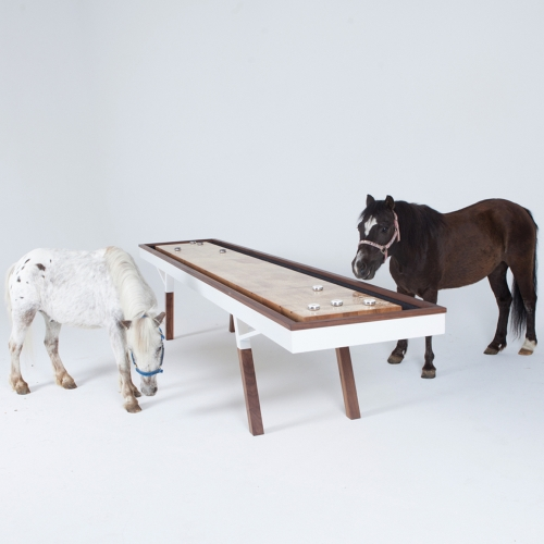 The Woolsey Shuffleboard table, completely crafted in California, is made of White Oak, Walnut and steel. Available in different sizes. Ponies not included.
