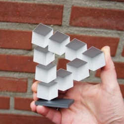 Penrose triangle, optical illusion made real with 3D printing via Shapeways