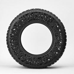 Belgian artist Wim Delvoye created a series of decorative objects by hand-carving intricate patterns and floral motifs on used car tires.