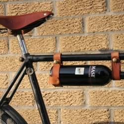 The Oopsmark Bicycle Wine Holder, a beautiful leather & brass wine holder for your bicycle by Canadian based designer Jesse Herbert.