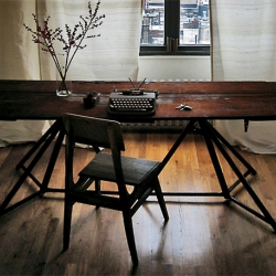 Workstead Table - Composed of 100% reclaimed materials, the table is built from two steel stands formerly used to support the structure of a ship's hull.