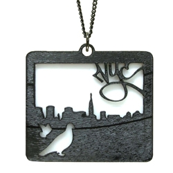 WrecordsByMonkey. Cityscape is made from recycled vinyl record with acrylic on a gunmetal chain, and pendant has urban inspired images: the New York City skyline, pigeons, and graffiti text