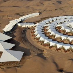Like a ship floating in the desert, shaped like a lotus, the concrete-free Desert Lotus Resort in Inner Mongolia is a sustainable solution to human accommodation within a natural environment.