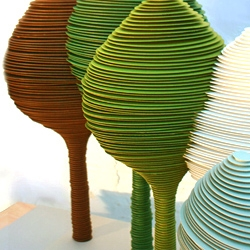 Multi awarded duo Yael Mer & Shay Alkalay from Raw Edges Studio created a super nice series of 12  revolving paper trees planted on a non revolving paper and wood console Table.