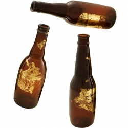 Who says beer isn't chic? This is a product from Vivre.com: hand etched vases made out of recycled beer bottles and gold leaf.