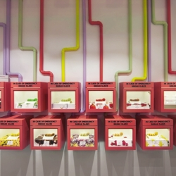 Sydney's colorful new Zumbo Patisserie uses factory-like elements in a magical way!