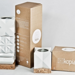 Kopia  modular tableware family made in porcelain and cork, inspired by an ancient Hungarian ritual of 18th century by István Böjte.