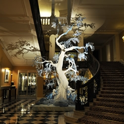 Dior's wonderfully bizarre tropical/winter wonderland Christmas tree for Art-deco London hotel Claridges is a very different kind of Christmas.... the sort that only John Galliano could have imagined....