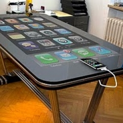 "Via the Table Connect App you can gain complete control over your iPhone using the multitouch table ... big time! All your apps and data can now be accessed via the 58"" capacitive multitouch surface."