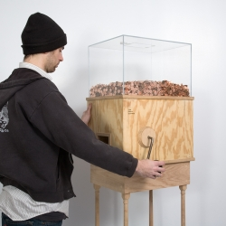 Blake Fall-Conroy's Minimum Wage Machine allows anybody to work for minimum wage. Turning the crank will yield one penny every 5.7 seconds, £6.31 an hour, the UK minimum wage.