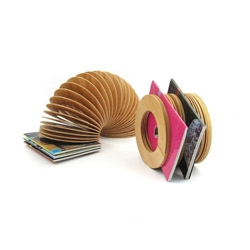 "Australian designer John Quan has made a Slinky-inspired magazine rack, ""Sexy Explosions"" out of colour pencils and produced a new way of serving Vietnamese rice paper rolls."