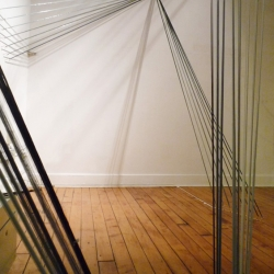 Halfway between instrument and sculpture, Strings is a sound installation that invites participants to play, hear and move within a space, becoming part of a musical instrument.