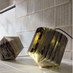 Entre Lineas is a collection of handmade paper lights made by mn*ls. Created from handfolded old books, inspired by the traditions of ready-made