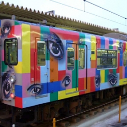 Of the countless trains running on Japan's 12,000 miles rail network, a few are decorated with images of anime and manga characters, colorful ads, and designs by notable artists