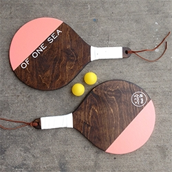 Of One Sea hand crafted paddleball set - hand-carved and hand-painted birch plywood by husband and wife duo (Thornton Chase Made) in the Northern Californian mountains.