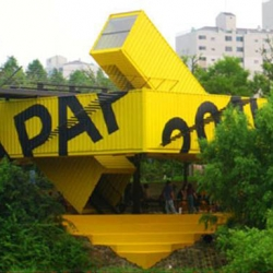APAP OPEN SCHOOL, by Lot-Ek in Anyang, South Korea. Designed for Anyang Public Art Project (APAP), is strategically positioned over Hakwoon park pedestrian walkway along the Anyang River