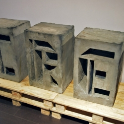 Concrete typographic type installation by Jim Wong